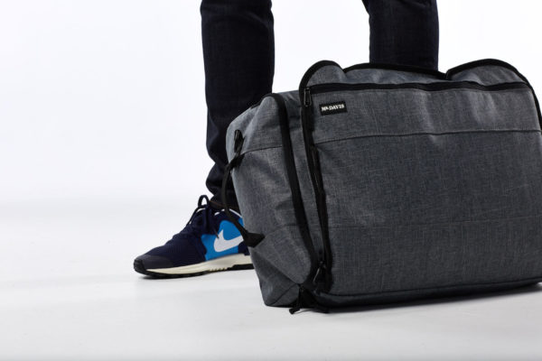 For tight quarters, like when you're on public transport, zip up both the shoulder and backpack straps for a snag-free city bag.